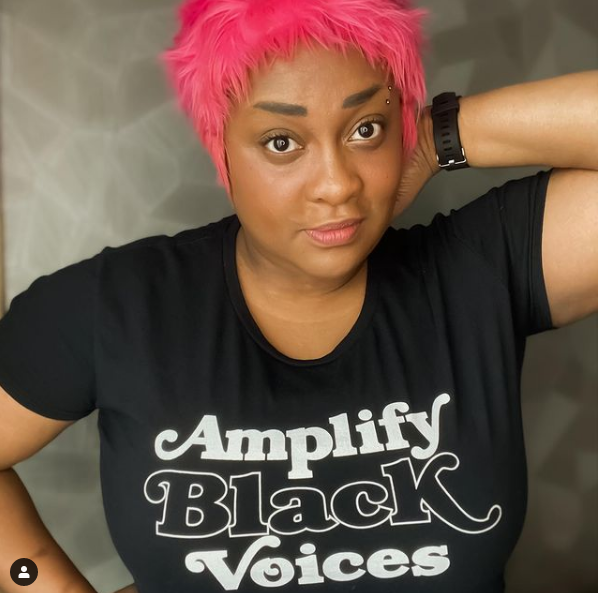"""Jamila C with pink hair and """"Amplify Black Voices"""" t-shirt"""