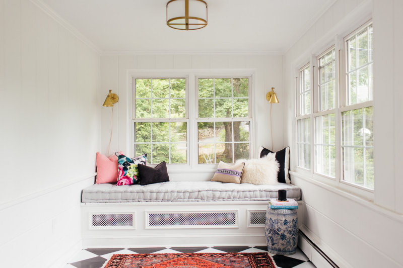 A window seat in a white room