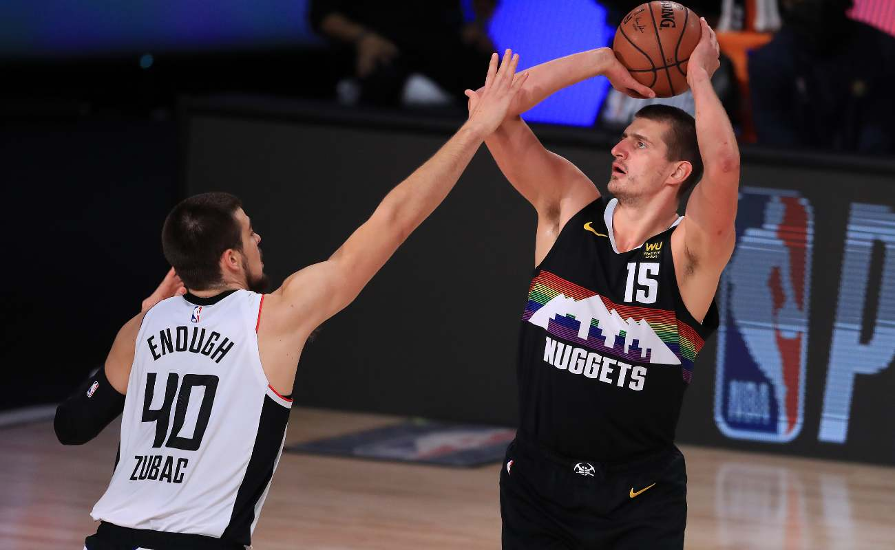 Nikola Jokic of the Denver Nuggets shoots over Ivica Zubac of the LA Clippers.