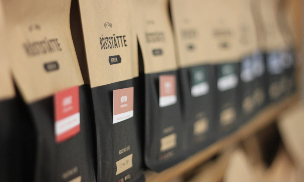 shelf lined with sustainable coffee bags
