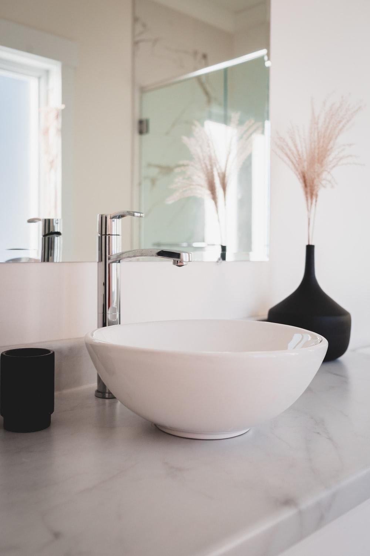 white ceramic bowl on black table