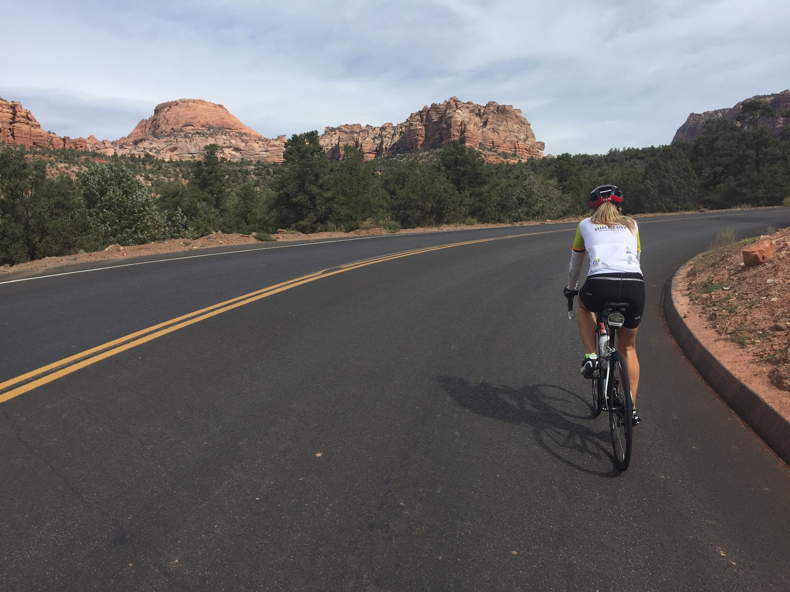 Cycling Kolob Terrace - cyclists riding towards mountains