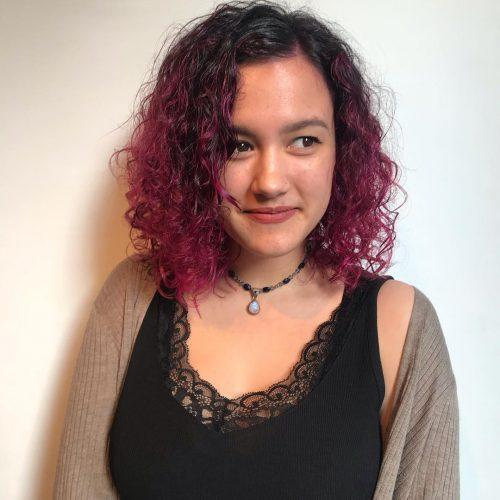 Naturally curly locks with magenta color
