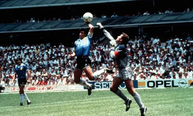 Diego Maradona doing the Hand of God goal that made Argentina won against England 2-1 in the 1986 World Cup quarter finals.