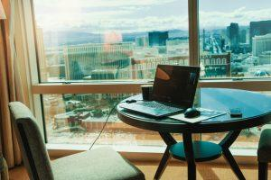 A mac on a table and a view on Las Vegas