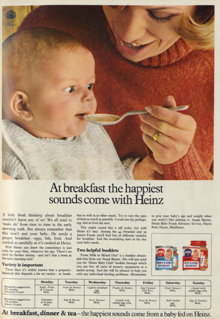A person feeding a baby Description automatically generated with medium confidence