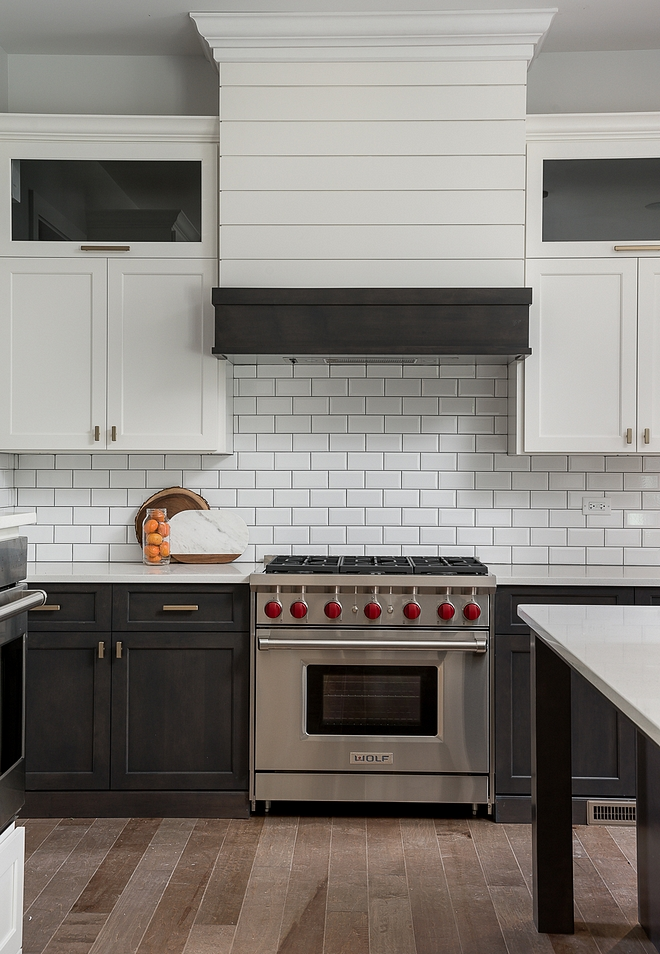 modern farmhouse kitchen design with brown shaker base cabinets and white shaker upper cabinets