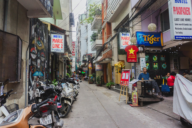 Looking for things to buy in shops down alleyways in Vietnam.