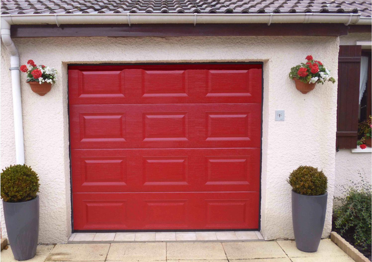 Devis porte de garage sectionnelle sur mesure for Achat porte garage sectionnelle