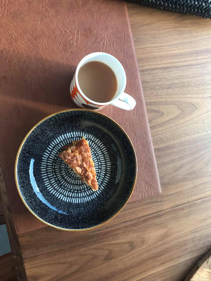 A picture containing table, sitting, food, coffee  Description automatically generated