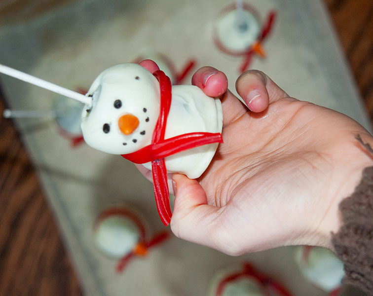 Image of cookie pop decorated as a snowman