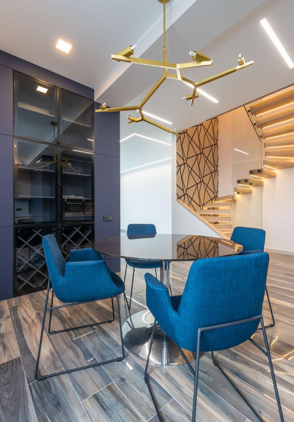 Dining room with angular style; interior decorating Brevard; Michael Gainey Signature Designs