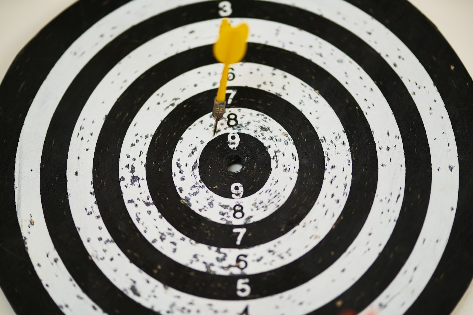 A target with a dart in it. Goals and targets play a big role in figuring out how to learn a language.