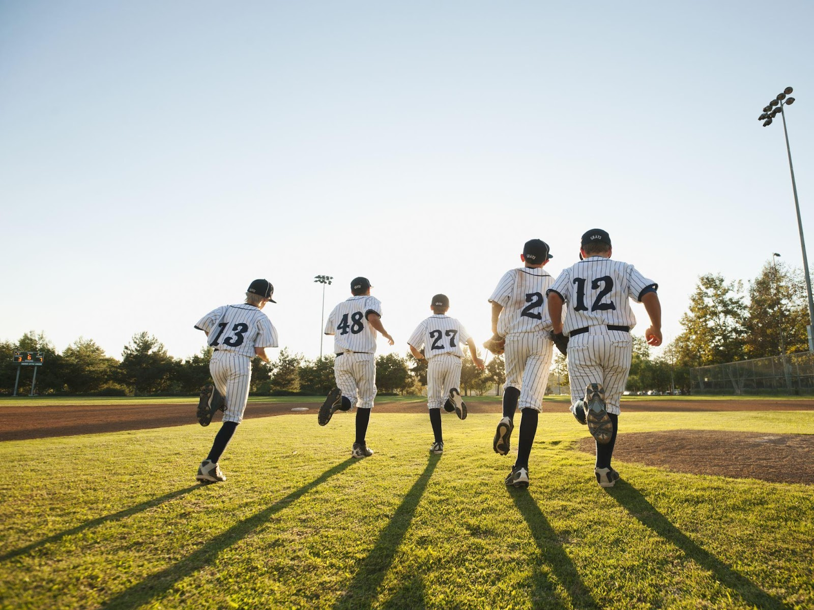 Baseball players running on field
