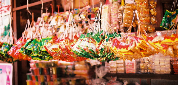Myanmar snacks hanging at a stall