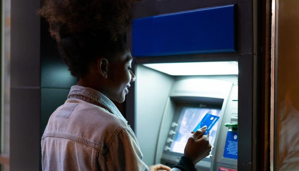 woman at atm at night