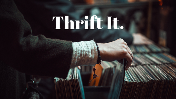 A person searching through old vinyl albums with the words Thrift It superimposed on the image