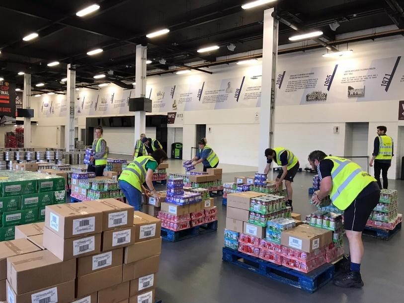 Volunteers picking and packing surplus food from FareShare South West's new emergency storage unit at Ashton Gate Stadium, Bristol. Much of this food is destined for Devon & Cornwall.
