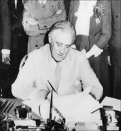 FDR signing the GI Bill into law