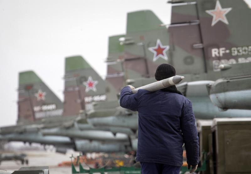 A serviceman carries a air-to-ground missile next to Sukhoi Su-25 jet fighters during a drill at the Russian southern Stavropol region, March 12, 2015.