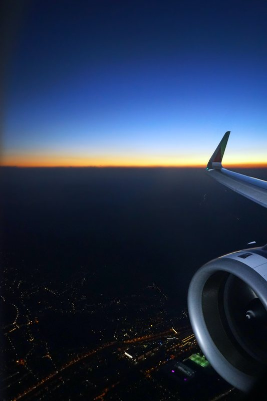 night time view from a plane, looking at the horizon