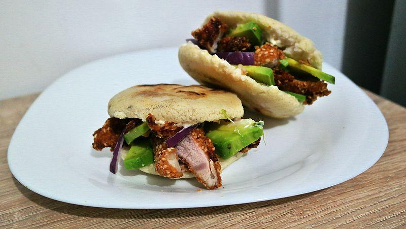 C:\Users\USER\Desktop\Files\writing job\The Vine Productions\New Client Job\July 2021\90099-0189JR\Arepas_with_chicken_schnitzel,_avocado,_mayonnaise_and_red_onion.jpg