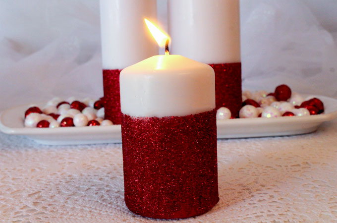 White unscented pillar candles dipped in glitter