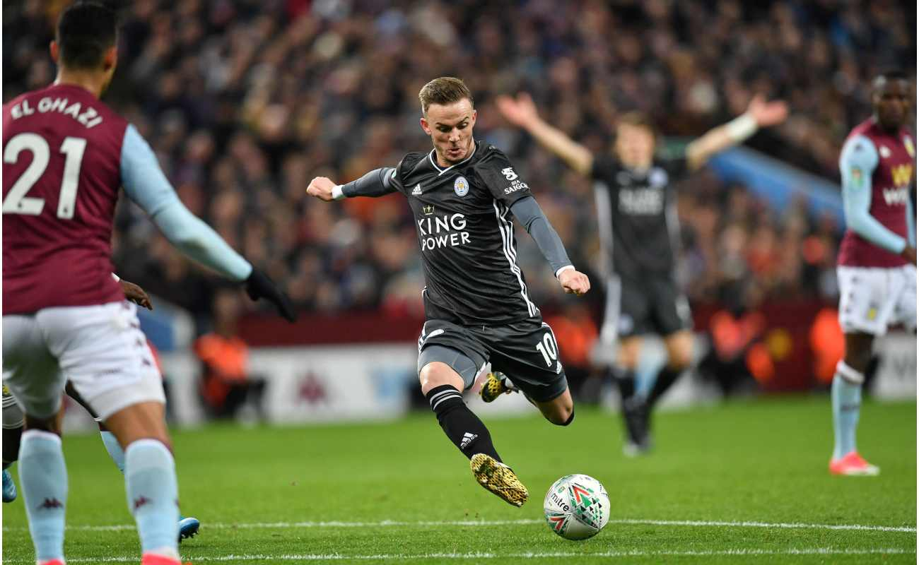 Leicester City midfielder James Maddison takes a shot on goal in a Premier League match against Aston Villa.