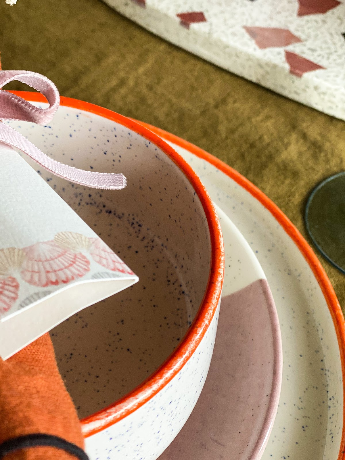 orange and speckled blue dinnerware details