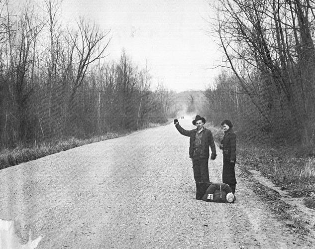 black and white men on side of street