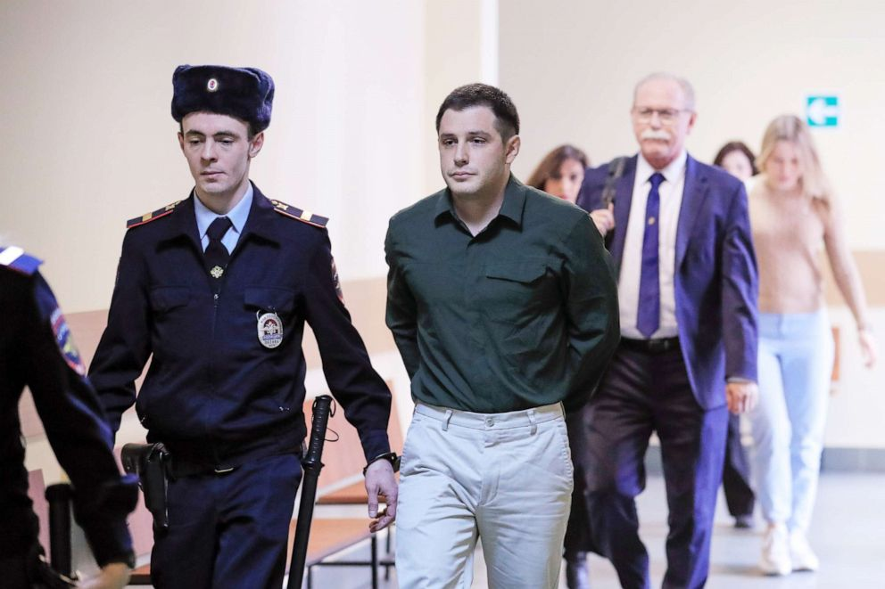 PHOTO: U.S. ex-Marine Trevor Reed, who was detained in 2019 and accused of assaulting police officers, is escorted before a court hearing in Moscow, March 11, 2020.