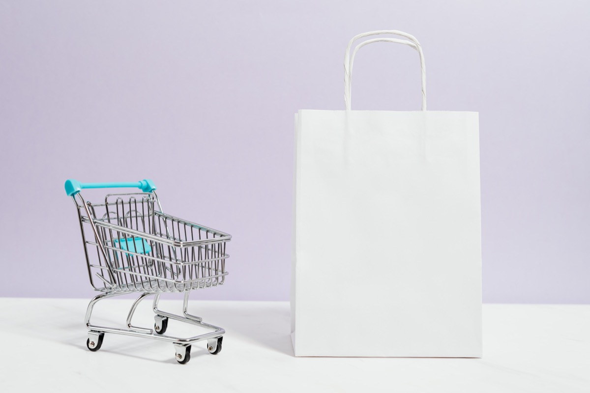 toy shopping cart and tiny shopping bag; running a successful flash sale concept