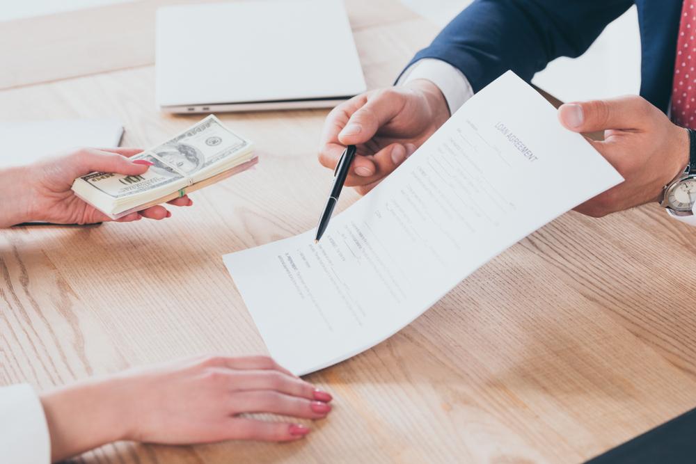 tính lãi suất vay tại tổ chức tín dụng
