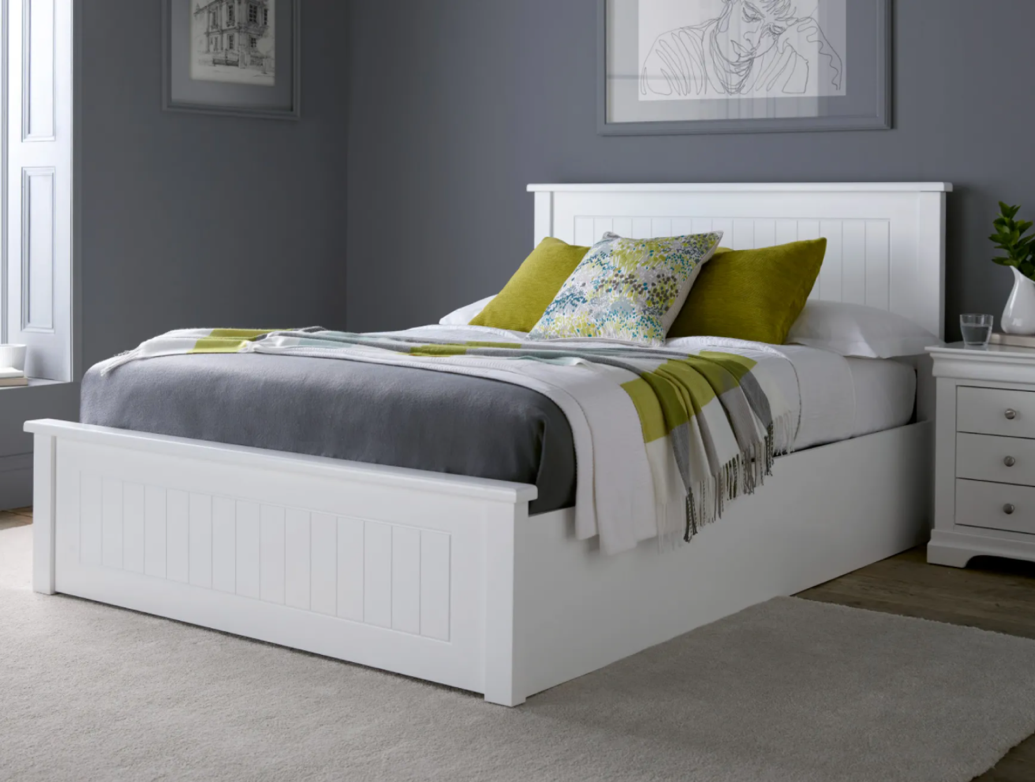 new england white wooden storage ottoman bed in a bedroom setting