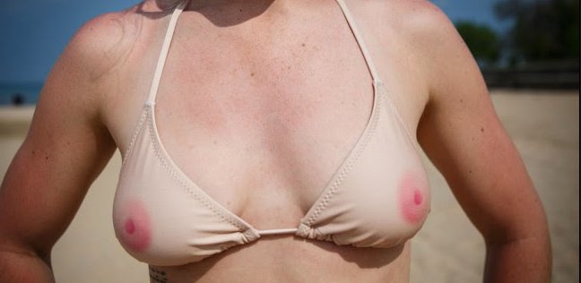 Lady's chest, wearing a bikini top that is skin-toned and has nipples on it. (from http://therightrant.blogspot.ca/)