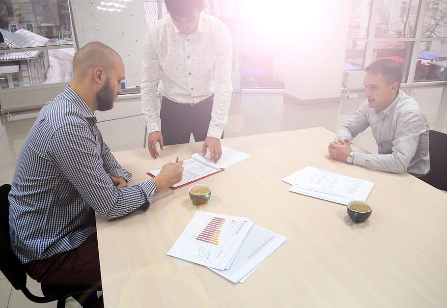 man, holding, pen, signing, contract, brown, wooden, table, wooden table, people