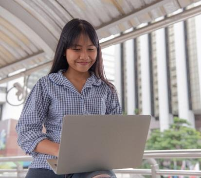 asian girl chatting on laptop in asian chat room