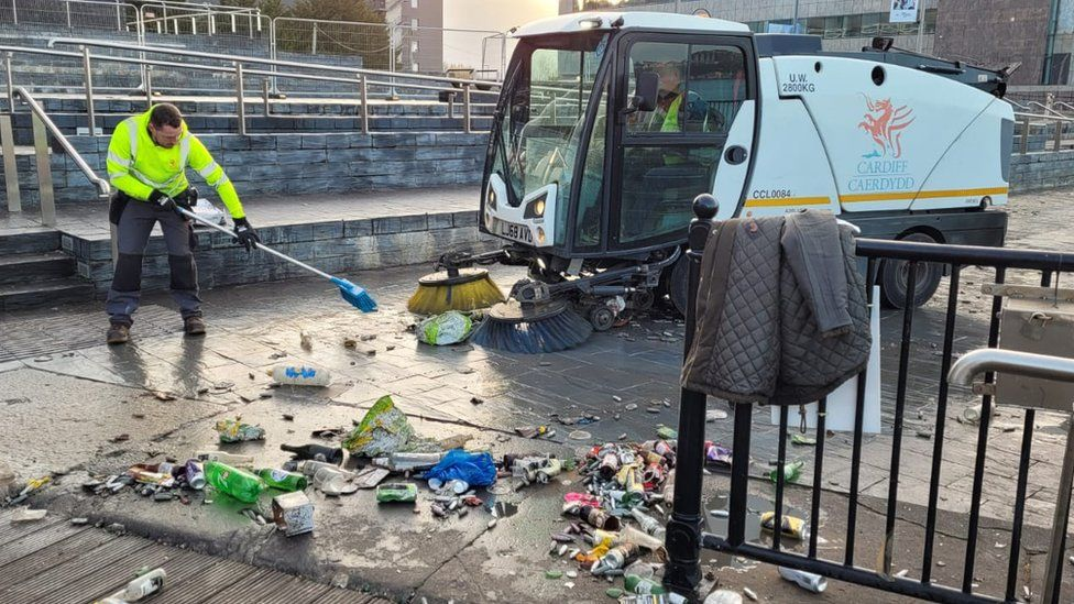Street cleaning outside the Welsh Parliament on Saturday morning