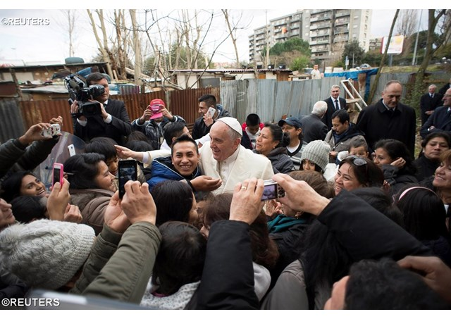 Archive photo of Pope Francis visiting a deprived area on the outskirts of Rome - REUTERS