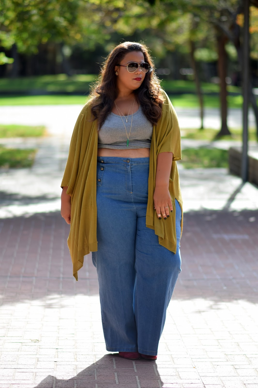 6 plus size bloggers to follow for your fall for Tucked in shirt plus size