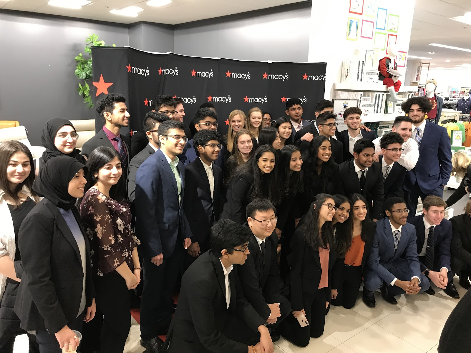 Fordson and Novi High School students taking an opportunity to pose for a photo together.