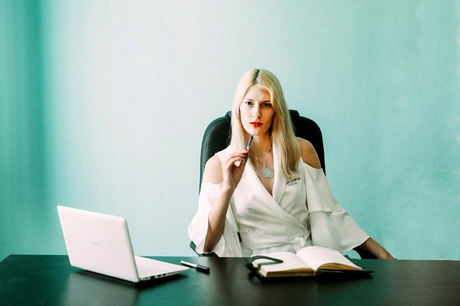Woman in her office thinking about something