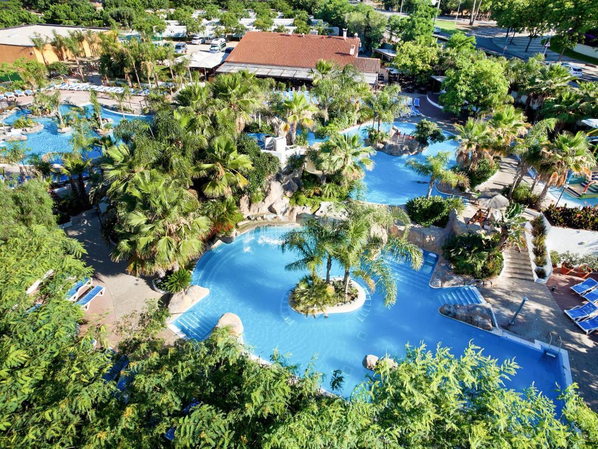 Kick back at any of the four palm tree-lined pools at La Siesta Salou Resort & Camping