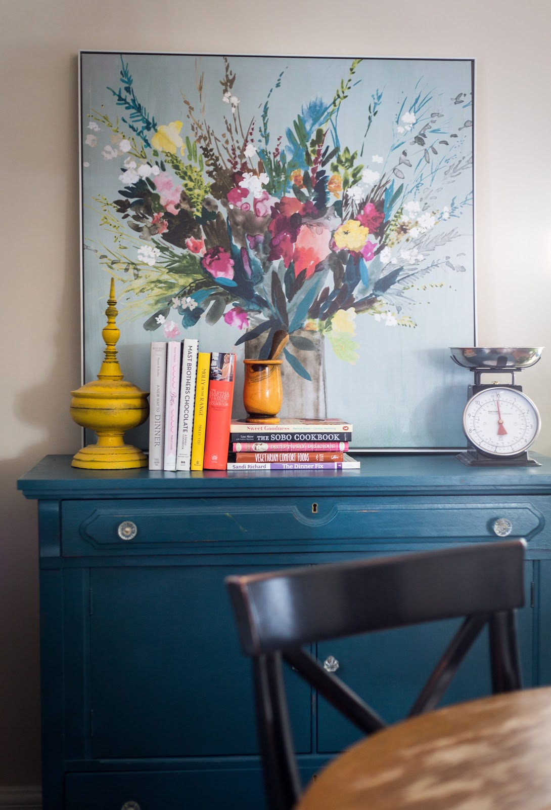 art travel finds and books from abroad displayed vignette blue cabinet calgary interior design leanne bunnell