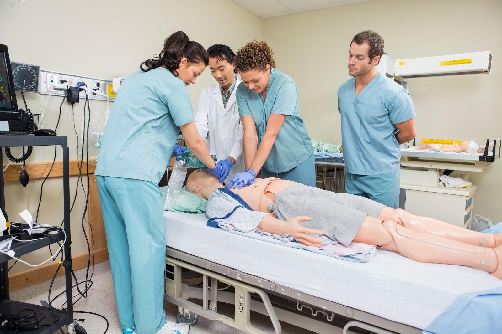 BSN Programs: Nurse performing CPR on dummy patient