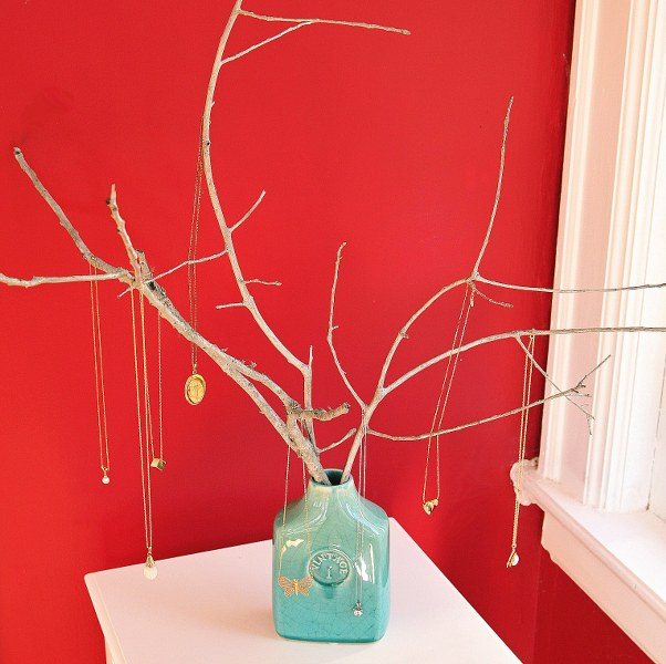 Faux branches are a great way to display necklaces & bracelets - and can double as decor!