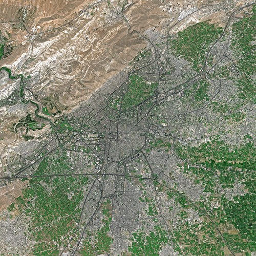 A 2006 satellite image of Damascus, Syria. Machine learning applied to such imagery is used in disaster relief an raises many ethical questions.