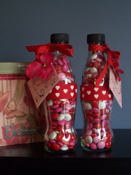 Save some 20 ounce pop containers, fill with Valentine's Day M&M's, decorate with tag and a ribbon, and you have the perfect Valentine's Day gift!: