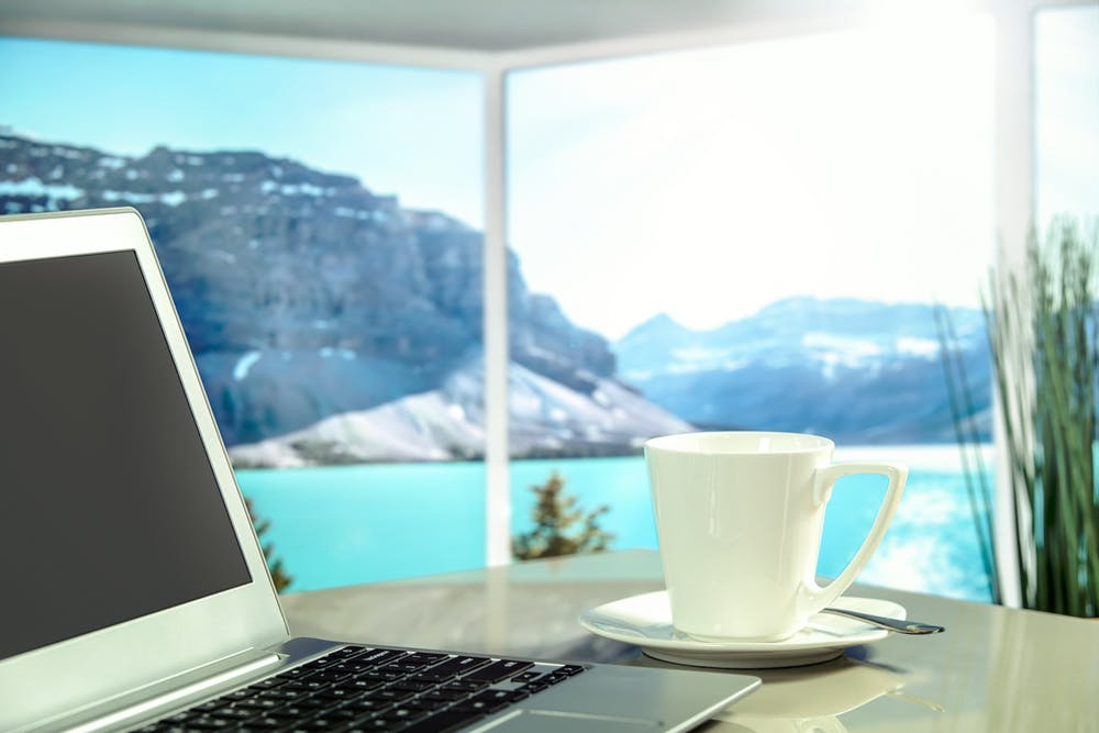Remote working desk in-between mountains and a lake