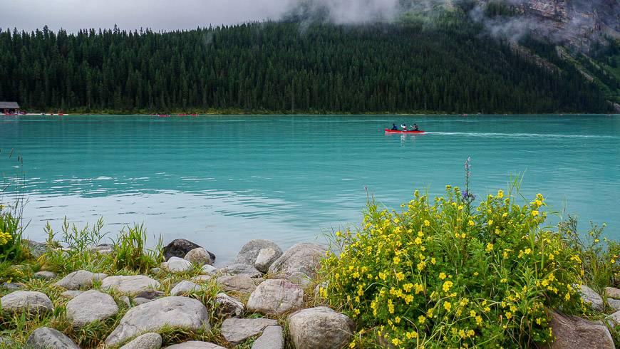 Paddle a red canoe on Lake Louise in summer